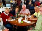Friends enjoying Johnny's Kitchen & Tap Octoberfest in Glenview