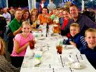 Family enjoying Johnny's Kitchen & Tap Octoberfest in Glenview