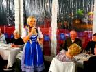 Blonde Date vocalist performing at Johnny's Kitchen & Tap Octoberfest in Glenview