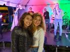 Happy participants enjoying DejaVu - St. Nectarios Greekfest, Palatine