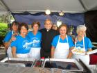 Church leader with volunteers -  St. Nectarios Greekfest, Palatine
