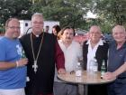 Church leader with volunteer and guests - St. Sophia Greekfest, Elgin