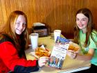 Young customers enjoying lunch at Nick's Drive In Restaurant Chicago