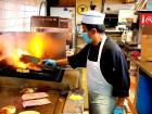 Cooking the famous burgers at Nick's Drive In Restaurant Chicago