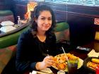 Happy customer enjoying dinner at Rose Garden Cafe in Elk Grove Village