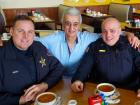 Friendly staff with police officers at Tasty Waffle Restaurant in Romeoville