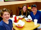 Family enjoying lunch at The Works Gyros in Glenview