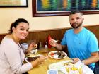 Couple enjoying the famous gyros at The Works Gyros in Glenview