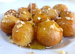 Greek Loukoumades, made of deep fried dough coated in honey syrup and cinnamon
