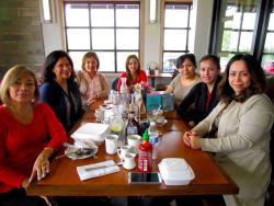 Friends enjoying birthday party at Butterfield's Pancake House & Restaurant in Wheaton