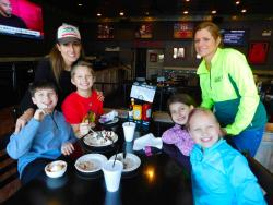 Families enjoying lunch at Draft Picks Sports Bar in Naperville