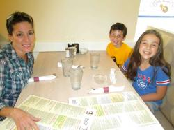 Family enjoying lunch at Eggs Inc. Cafe - Chicago