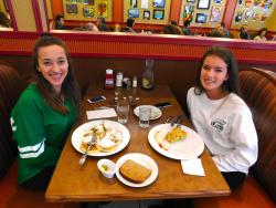 Friends enjoying breakfast at Georgie V's Pancakes & more in Northbrook