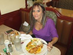 Loyal patron enjoying breakfast at Omega Restaurant in Downers Grove