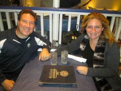 Couple enjoying dinner at Mykonos Greek Restaurant in Niles