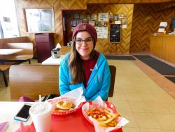 Happy customer enjoying lunch at Nick's Drive In Restaurant in Chicago