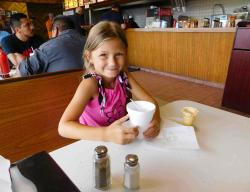 Young customer enjoying ice cream with her Mom at Nick's Drive In Chicago