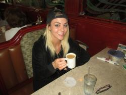 Customer having coffee at Omega Pancake House in Downers Grove
