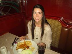 Customer enjoying breakfast at Omega Restaurant & Pancake House in Downers Grove