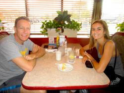 Family enjoying breakfast at Omega Restaurant & Pancake House in Downers Grove