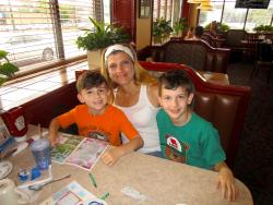 Mom and sons enjoying breakfast at Omega Restaurant & Pancake House in Downers Grove