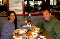 Couple enjoying breakfast at Omega Restaurant & Pancake House in Schaumburg