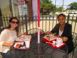 Friends enjoying lunch on the outdoor patio at Plush Pup Gyros in Chicago