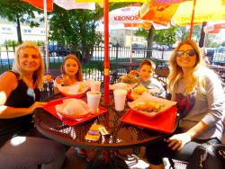 Family enjoying lunch at Plush Pup Gyros in Chicago