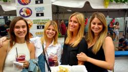 Friends enjoying the annual Taste of Greek Town on Halsted St. in Chicago