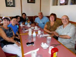 Friends enjoying lunch at Village Inn Restaurant in Huntley