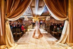 Bride entering ceremony room at Concorde Banquets in Kildeer - photo credit Andre LaCour