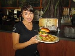 Friendly staff serving the classic burger at Xando Cafe in Hickory Hills