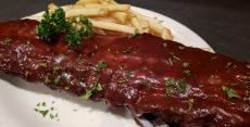 The famous BBQ Baby Back Ribs at Andrew's Open Pit & Spirits in Park Ridge