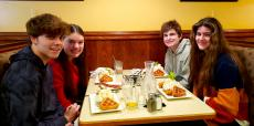 Friends enjoying the famous waffles at Annie's Pancake House in Skokie