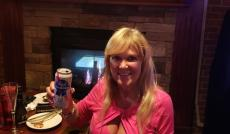 Customer enjoying happy hour specials at Anyway's Pub & Restaurant in Bloomingdale