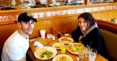 Couple enjoying breakfast at Apple Villa Pancake House in Hoffman Estates