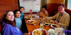 Family enjoying breakfast at Apple Villa Pancake House in South Barrington