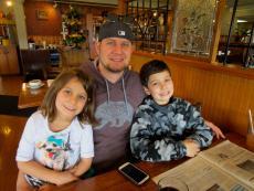 Family enjoying breakfast at Billy's Pancake House in Palatine