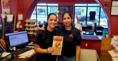 Friendly staff serving lunch customers at Brandy's Gyros in Hanover Park