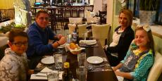 Family enjoying dinner at Brousko Authentic Greek Cuisine in Schaumburg