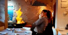 Serving flaming Saganaki at Brousko Authentic Greek Cuisine in Schaumburg