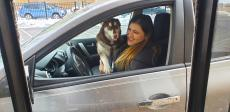 Happy drive-thru customer at Charcoal Delights Restaurant in Chicago