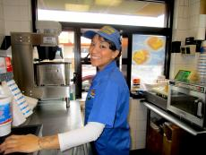 Friendly drive-thru worker at Charcoal Delights Restaurant in Des Plaines
