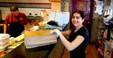 Friendly carryout staff at Charcoal Flame Grill in Morton Grove