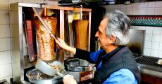 Slicing the famous homemade gyros at Charcoal Flame Grill in Morton Grove