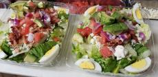 The famous signature salad at Charcoal Flame Grill in Morton Grove