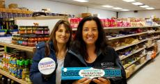 Happy shoppers at Columbus Food Market and Gifts in Des Plaines