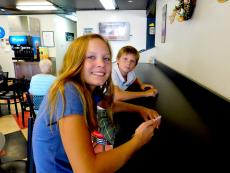 Brother and sister enjoying lunch at Craving Gyros in Lake Zurich