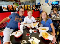 Family enjoying lunch at Craving Gyros in Lake Zurich