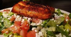 Village salad with grilled salmon at Demetri's Greek Restaurant in Deerfield